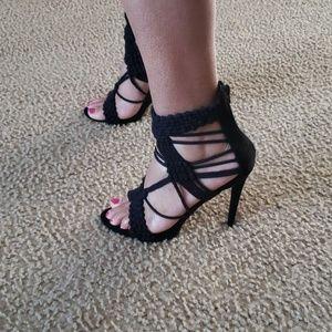 Black stiletto heeled sandals